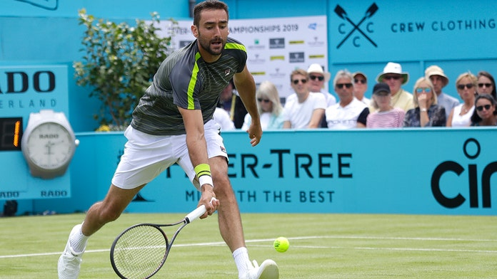 Cilic begins Queen's Club title defense with win