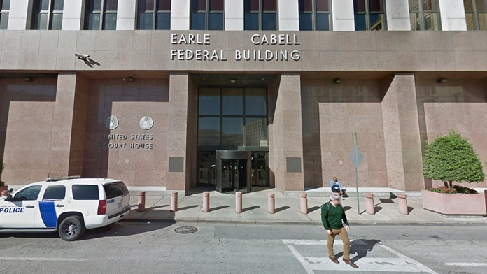 Masked gunman arrested after opening fire outside Dallas federal courthouse