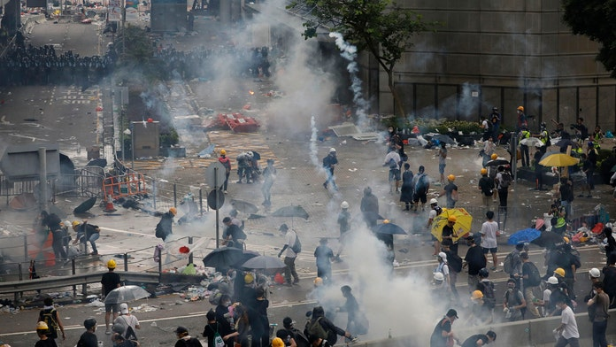 Hong Kong extradition bill debate delayed as police reveal they used over 150 rounds of tear gas on protesters