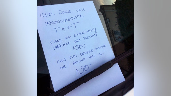 Offensive letter left on car as wealthy town's parking dispute spills into church
