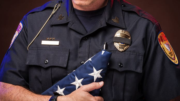 Police officers honor fallen comrade at his son's graduation party