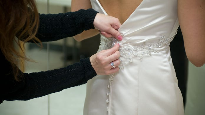 Mother-in-law wears wedding dress to her son's wedding, but not for the reason people assumed