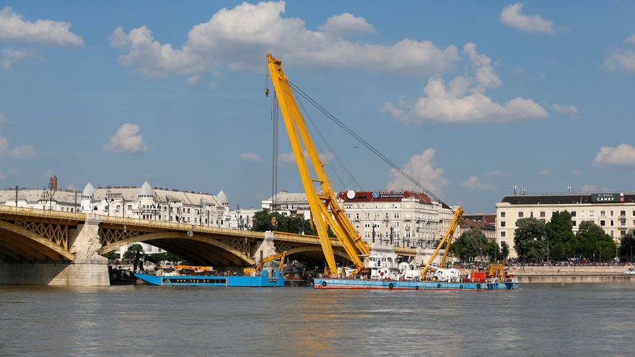 Salvage teams work to raise sunken tourist boat to Danube surface
