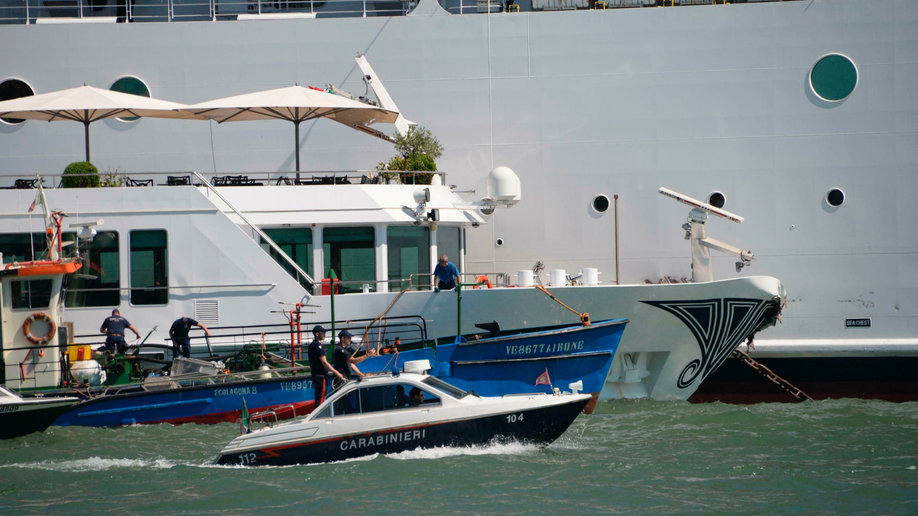 Cruise ship loses control, slams Venice wharf and tourist boat