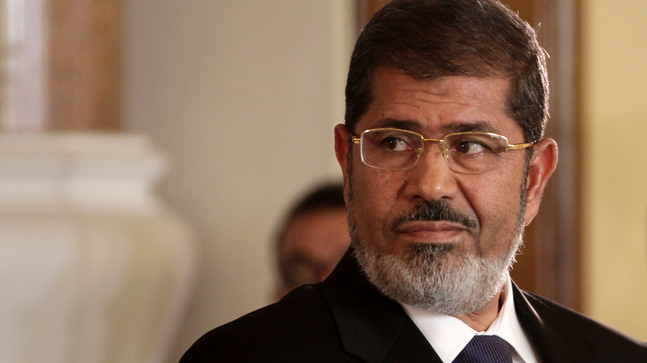 Funeral prayers in absentia held for Morsi