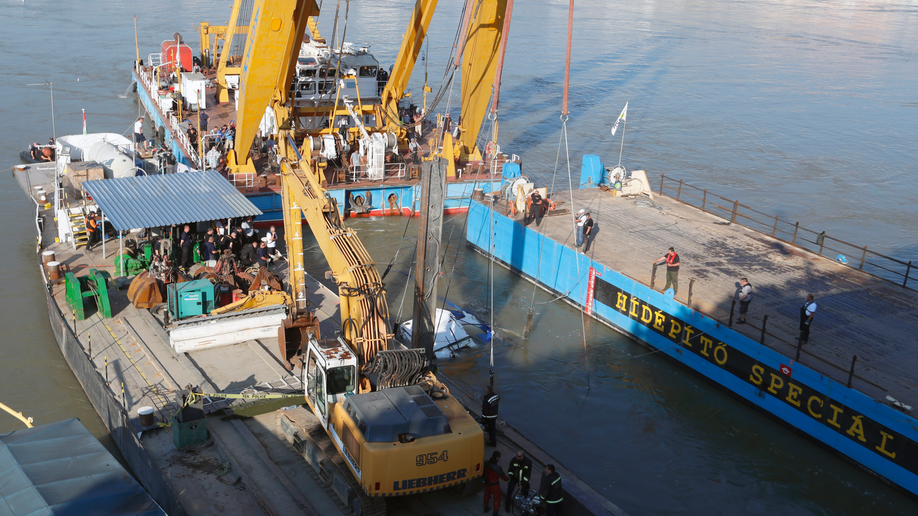 Salvage crews start operation to lift Hungarian boat sunk in Danube