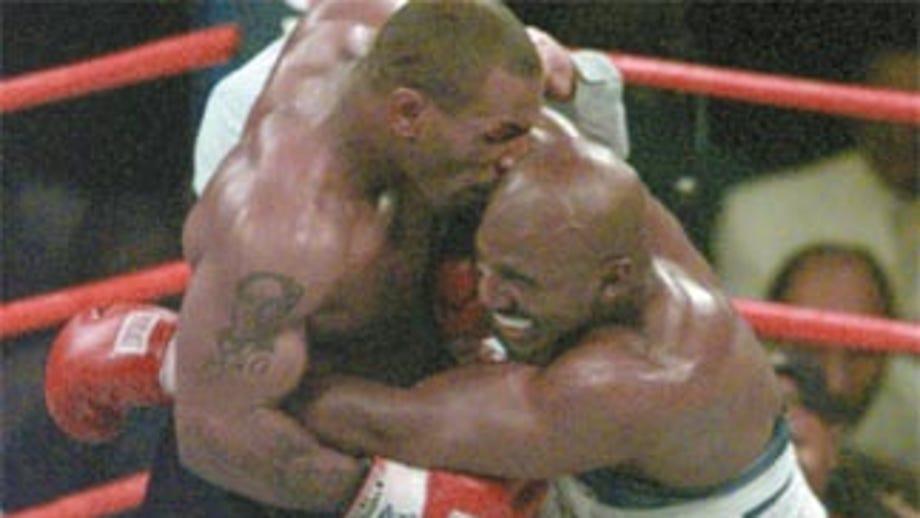 Mike Tyson eats Roy Jones Jr.'s 'ear' in Thanksgiving video, makes Evander Holyfield joke