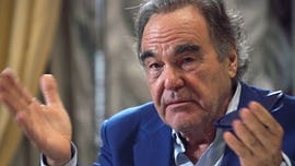 Oliver Stone asks Putin to be his daughter's godfather in bizarre interview