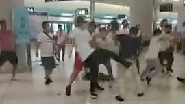 Hong Kong protests grow violent as masked assailants attack demonstrators, passengers at subway station