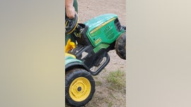 Missing Minnesota toddler found cruising on toy tractor at county fair
