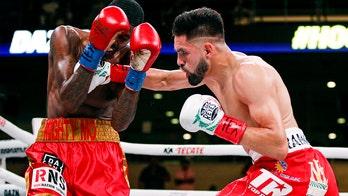 WBC's Ramirez gets TKO in super lightweight unification bout