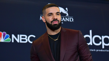Drake shares first public images of son Adonis: 'I love and miss my beautiful family'