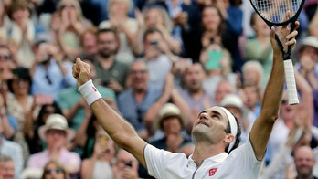 Roger Federer tops Rafael Nadal in first Wimbledon meeting since 2008 final
