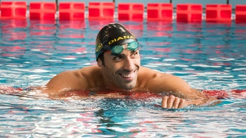 ecdf6f6bd1f Olympic swimmer Filippo Magnini saves drowning man after wind pushed him  off unicorn float