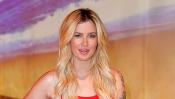 Ireland Baldwin shows off tattoos in new photos of herself doing ballet poses in red leotard
