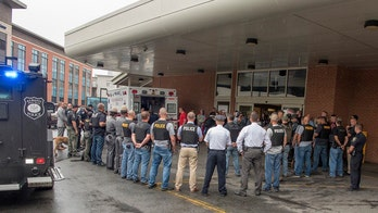 Officers line up in tribute to boy entering hospice with cancer