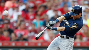 Milwaukee Brewers' Christian Yelich shatters boat window during batting practice