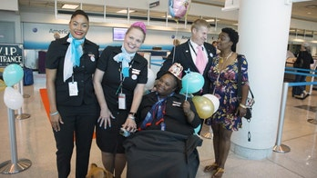 Teen headed for life-saving surgery gets surprise celebration from American Airlines flight crew