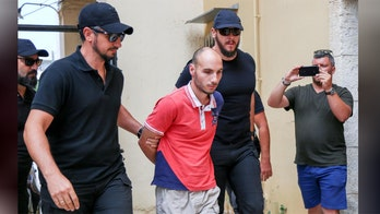 Priest's son charged in murder of American biologist in Greece as grisly new details emerge