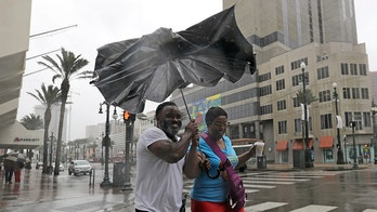 Barry makes landfall in Louisiana after weakening back to tropical storm