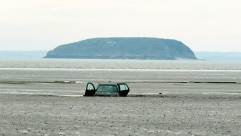 Sand trap? Gawkers flock to see Volkswagen Golf stuck on beach