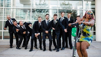 Mystery woman riding scooter photo-bombs wedding party, sparks viral search: 'We love her for it!'