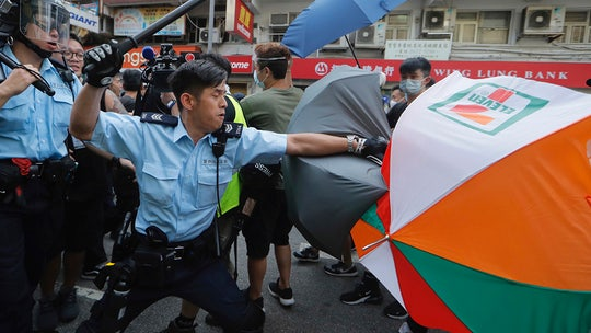 Clashes erupt as thousands march in Hong Kong against Chinese traders