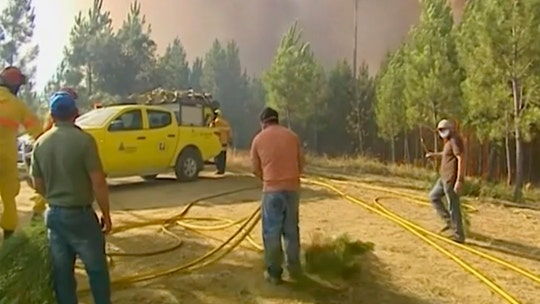 Hundreds of firefighters tackle wildfires in Portugal, village evacuated