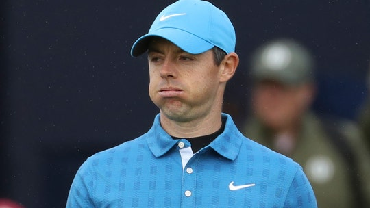 Rory McIlroy breaks woman's phone with errant tee shot on first hole of British Open