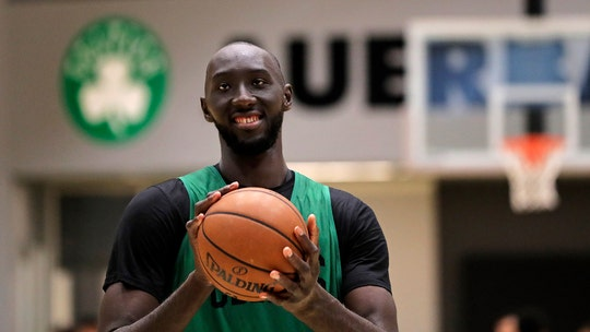 Boston Celtics rookie Tacko Fall signs several taco-related items at Massachusetts meet and greet