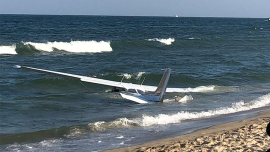 Small plane lands on water near Maryland beach in front of onlookers