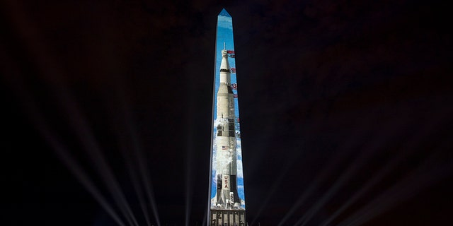 The image of a 363-foot Saturn V rocket is projected on the east face of the Washington Monument in Washington, Wednesday, July 17, 2019, in celebration of the 50th anniversary of the Apollo 11 moon landing. (AP)