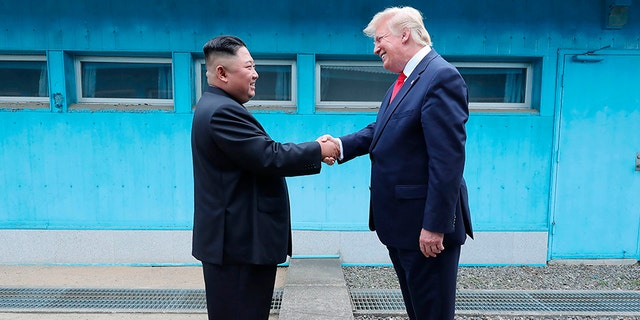 Kim Jong Un and President Trump shake hands over the military demarcation line at the border village of Panmunjom in the Demilitarized Zone in 2019. (Korean Central News Agency/Korea News Service/ AP)