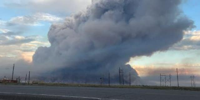 A fast-moving brush fire has prompted an evacuation of non-essential employees from the Idaho National Laboratory.