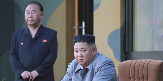 "In this Thursday, July 25, 2019, photo provided on Friday, July 26, 2019, by the North Korean government, North Korean leader Kim Jong Un watches a missile test in North Korea. A day after two North Korean missile launches rattled Asia, the nation announced Friday that its leader Kim supervised a test of a new-type tactical guided weapon that was meant to be a ""solemn warning"" about South Korean weapons introduction and its rival's plans to hold military exercises with the United States. Independent journalists were not given access to cover the event depicted in this image distributed by the North Korean government. The content of this image is as provided and cannot be independently verified."