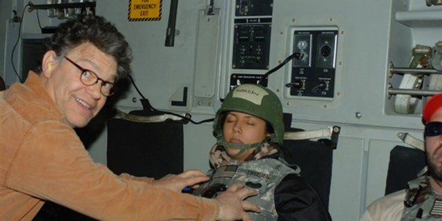 Al Franken is seen in a controversial photo that led to his resignation from the U.S. Senate in 2018.