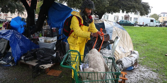 Robert Harris packs his belongings at a homeless camp in Lakeside Park on Thursday, Feb. 14, 2019, in Oakland, Calif. (Getty Images)