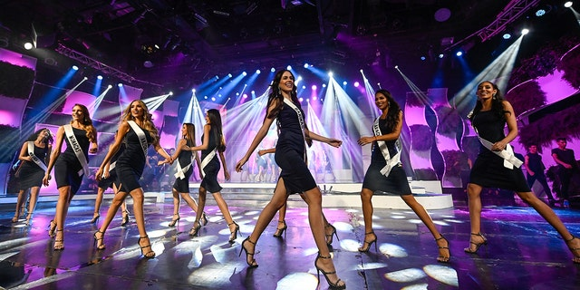 Contestants walk the catwalk during a 2019 Miss Venezuela beauty contest rehearsal, in Caracas, Venezuela on July 30, 2019. - For the first time, in the 2019 version of the Miss Venezuela contest, which will be held on Thursday, it won't be mentioned waist, hip and bust measurements of the candidates to avoid female gender stereotypes, the organization said. (Photo by Federico PARRA / AFP/Getty Images)