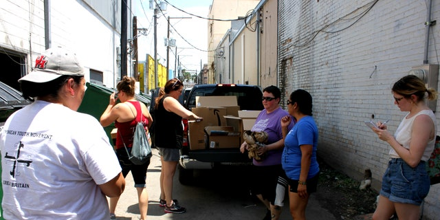 Abby Johnson and others getting ready to unload supplies at the respite center in McAllen, Texas.