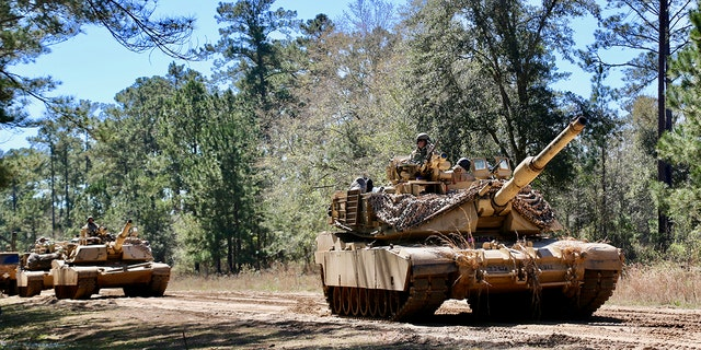 M1A1 Abrams main battle tanks assigned to 3rd Battalion, 67th Armored Regiment, 2nd Armored Brigade Combat Team, 3rd Infantry Division stage prior to a tactical movement during Spartan Focus, at Fort Stewart, Ga., Mar. 5.