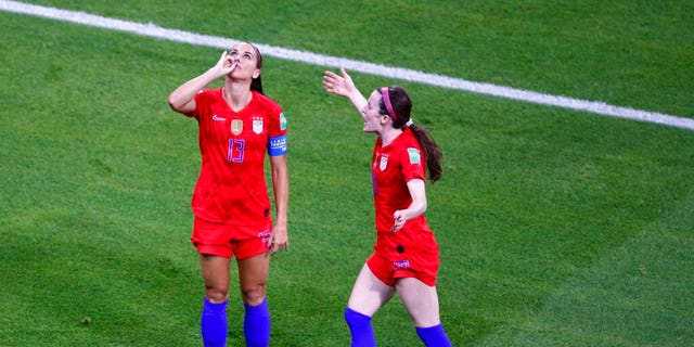 United States' Alex Morgan, left, celebrates her side's second idea during a Women's World Cup semifinal soccer compare between England and a United States, during a Stade de Lyon, Tuesday, Jul 2.
