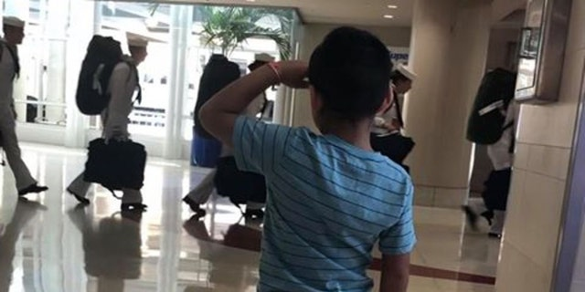 Jace Vega is going viral online for a photo of the six-year-old saluting members of the military at San Antonio International Airport. (Priscilla Pinales-Vega & Joe Vega)