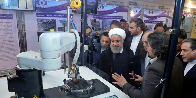 Iranian President Hassan Rouhani listening to explanations on new chief achievements during a rite to symbol National Nuclear Day, in Tehran progressing this year. (Iranian Presidency Office around AP, File)