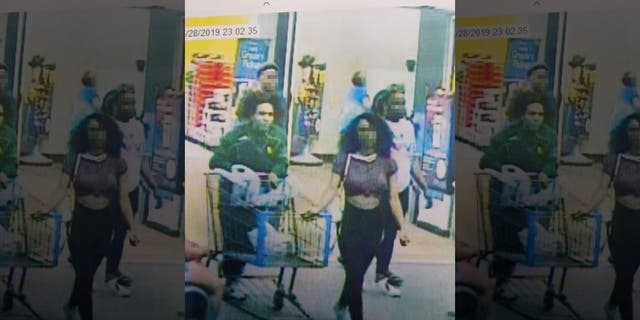 "Still from store video showing the suspected ""Blue Bell Licker"" and her boyfriend. The girl, a juvenile whose name has not been released, has been identified by Lufkin, Texas police as the person who licked a tub of ice cream in a Walmart store then put it back in the freezer. ​ (Lufkin Police & Fire)"