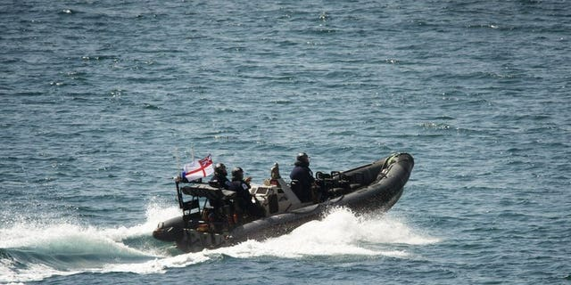 A Royal Marines vessel sails toward a Grace 1 super tanker off a British domain of Gibraltar Jul 4.