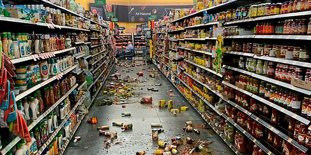 Food that fell from the shelves litters the floor of an aisle at a Walmart following an earthquake in Yucca Valley, Calif., on Friday, July 5, 2019. (Associated Press)