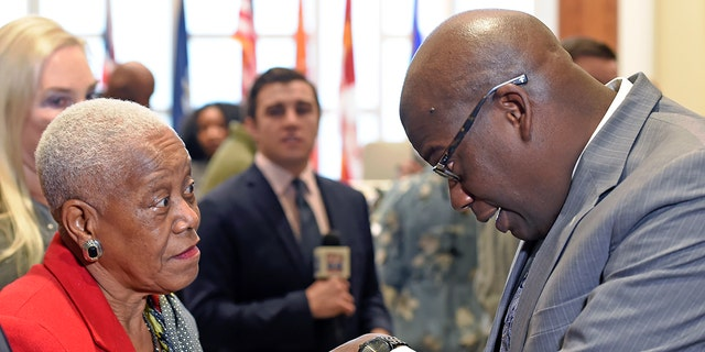 In a Friday Dec. 29, 2017, photo, Sadie Roberts-Joseph chats with Louisiana State Police Lt. Col. Murphy Paul.