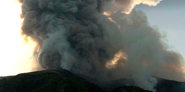 Smoke billows from the volcano on the Italian island of Stromboli, Wednesday, July 3, 2019. The news agency ANSA says that some 30 tourists jumped into the sea of ​​fear after a series of volcano erupted on the Sicilian island of Stromboli. Civil protection authorities said it was killed by the eruptions Wednesday. (ANSA VIA)