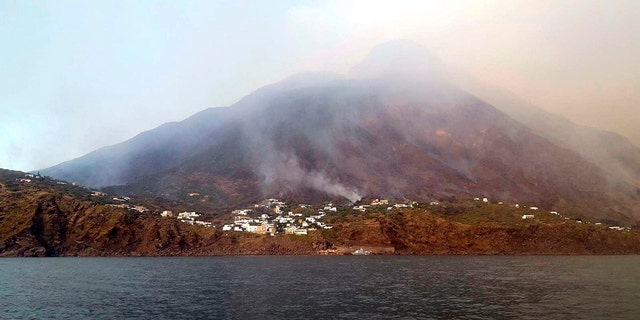 Smoke billows from the volcano on the Italian island of Stromboli, Wednesday, July 3, 2019. The news agency ANSA says that some 30 tourists jumped into the sea out of fear after a series of volcano erupted on the Sicilian island of Stromboli. Civil protection authorities said it was killed by the eruptions Wednesday. (ANSA VIA)