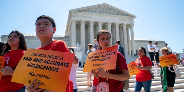 Young demonstrators gather at the Supreme Court as the justices finish the term with key decisions on gerrymandering and a census case involving an attempt by the Trump administration to ask everyone about their citizenship status in the 2020 census, on Capitol Hill in Washington, Thursday, June 27, 2019. (AP Photo/J. Scott Applewhite)